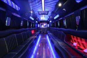 a big party bus fill ed with comfortable seats and shiny bright floor for dancing and having fun