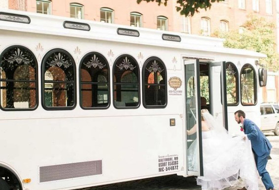 Image of bride and groom getting inside trolley