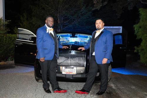Image of men outside of limousine