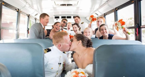 Couple and group of friends inside bus on American Limousines website